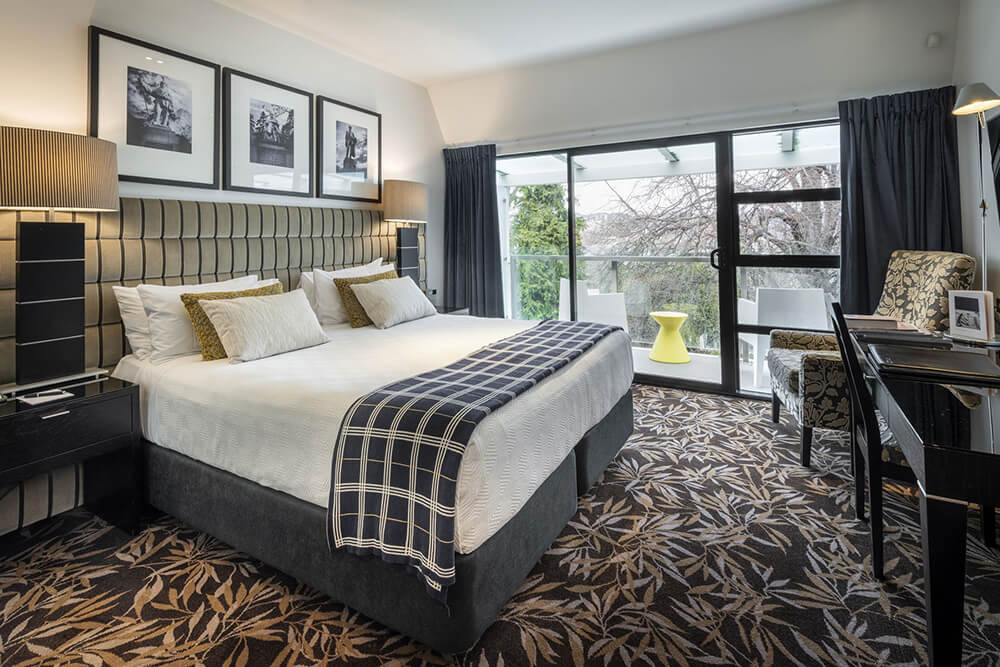 Premium Executive King Room with a balcony at The George hotel in Christchurch
